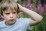 Portrait of little boy on meadow in the garden - MJF02127