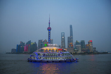 China, Shanghai, view of financial district at Pundong with tourboat in the foreground - EA00017