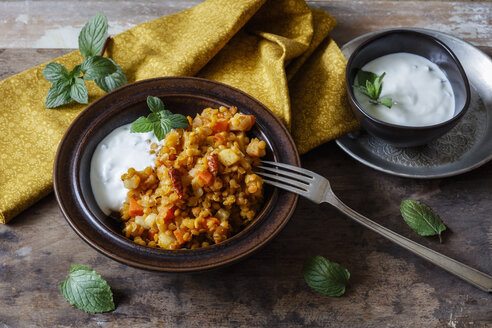 Cooked red lentils with vegetables and natural yoghurt with mint - EVGF03257