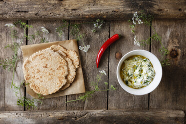 Home-baked Naan bread and bowl of curd dip - EVGF03263