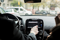 Close-up of businessman using navigation device in car - MAUF01171