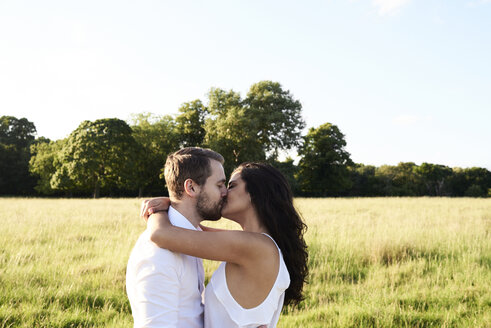 Kissing young couple in nature - IGGF00051