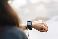 Woman checking her smartwatch - GIOF02981