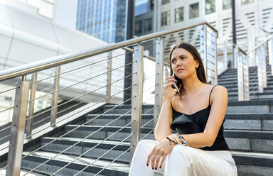 Young woman on the phone in the city - MGOF03498
