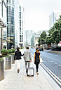 Businesspeople walking through the city - MGOF03507