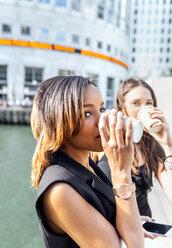 Two women having a coffee break in the city - MGOF03531
