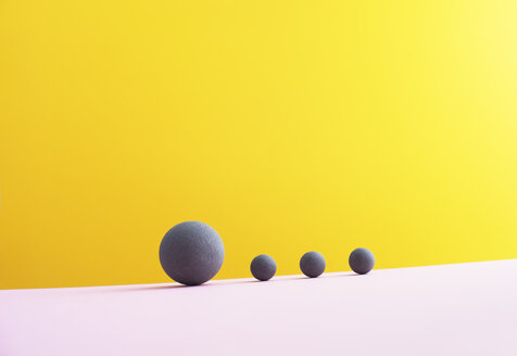 Four spheres against yellow background, 3D Rendering - DRBF00002