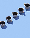 Five coffee cups on light blue ground, 3D Rendering - DRBF00011