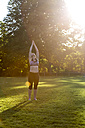 Woman doing yoga in park - JFEF00853