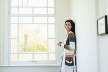 Portrait of smiling woman at home - JOSF01290