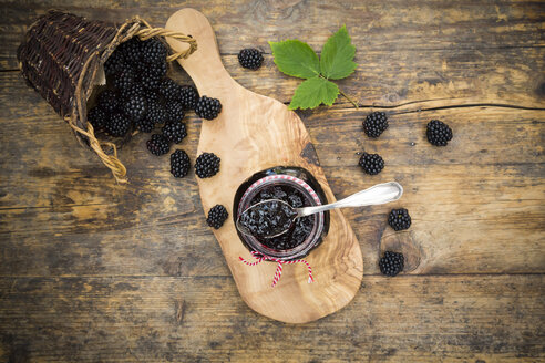 Glass of blackberry jelly and blackberries on wood - LVF06274