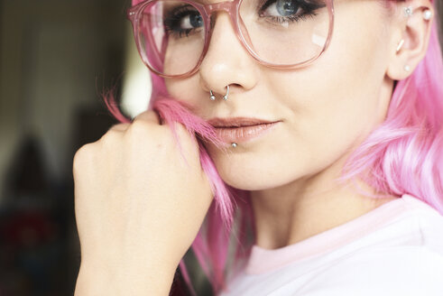Portrait of young woman with pink hair, glasses and piercings - IGGF00067