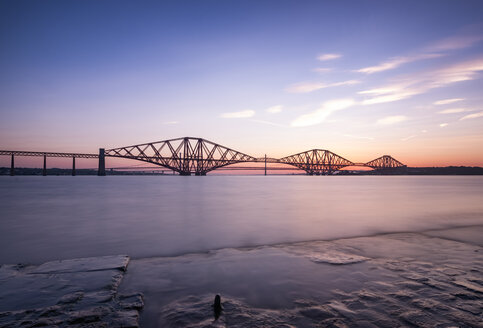 UK, Scotland, Fife, Edinburgh, Firth of Forth estuary, Forth Bridge, Forth Road Bridge and Queensferry Crossing in the background at sunset - SMAF00813