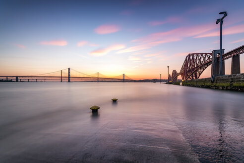 UK, Scotland, Fife, Edinburgh, Firth of Forth estuary, view from South Queensferry of Forth Bridge, Forth Road Bridge and Queensferry Crossing Bridge at sunset - SMAF00816