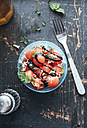 Watermelon salad with eschalot, mint, olive oil and balsamico in bowl - IPF00406