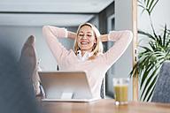 Businesswoman having a break in office - UUF11447