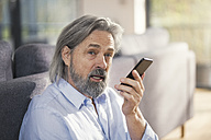 Senior man using smartphone - SBOF00490