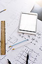 Tablet and construction plan on desk - GIOF03042