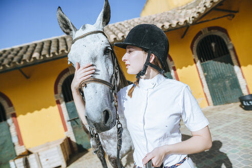 Young rider with horse - KIJF01703