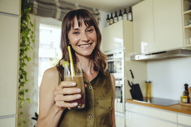 Woman holding her homemade smoothie - MFF03765