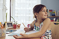 Girl doing her schoolwork at home - MFF03783