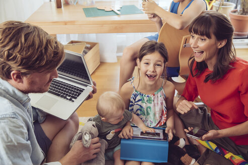 Happy playful family using digital devices in children's room - MFF03795
