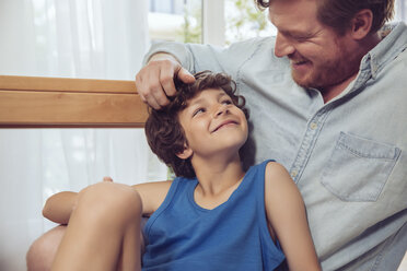Father tickling son's head - MFF03801