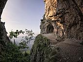Italy, Veneto, Strada delle 52 Gallerie, hiker on the move - LAF01853