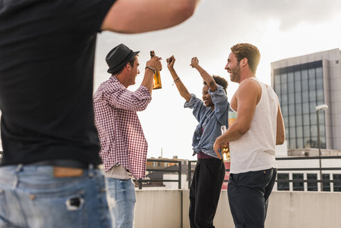 Friends having a rooftop party - UUF11477