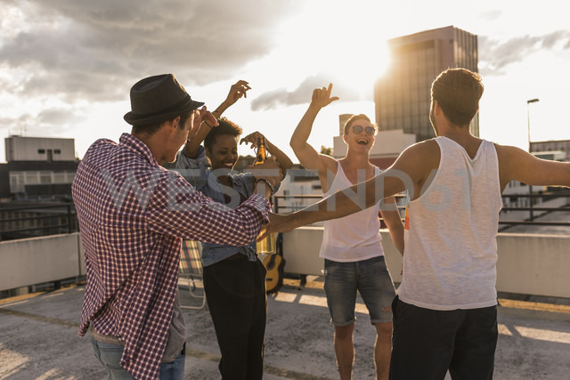 Friends having a rooftop party - UUF11480