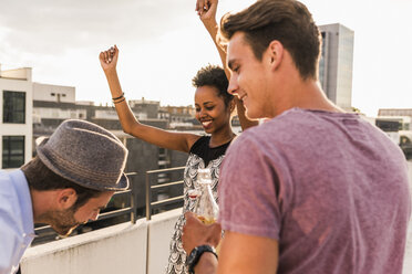 Friends having a rooftop party - UUF11498