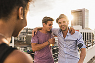 Friends having a rooftop party - UUF11501