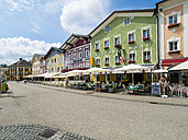 Austria, Mondsee, row of houses with restaurants in the foreground - AMF05458