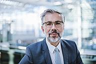 Portrait of confident businessman - DIGF02625
