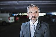 Portrait of confident businessman in parking garage - DIGF02634