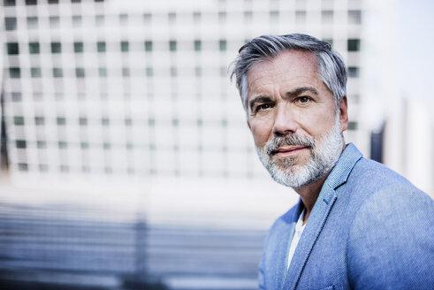 Portrait of confident businessman outdoors - DIGF02637