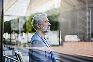 Portrait of grey-haired businessman outdoors - DIGF02643