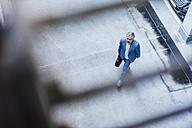 Businessman walking holding bag - DIGF02652