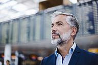 Portrait of confident businessman at a station - DIGF02658