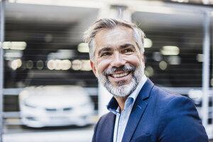 Portrait of smiling businessman - DIGF02667