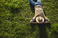 Young man sleeping on a meadow, top view - MRAF00213