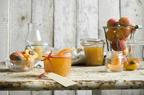 Glasses of homemade apricot jam and apricots - ASF06100