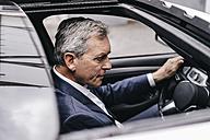 Businessman driving car - KNSF02375