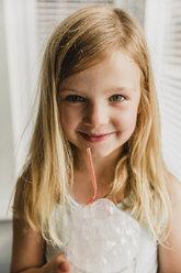 Portrait of blond little girl blowing milk bubbles - NMSF00140