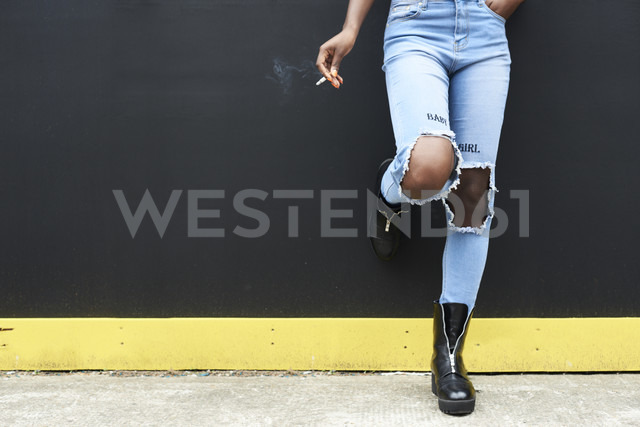 Legs of woman wearing used look jeans - IGGF00099
