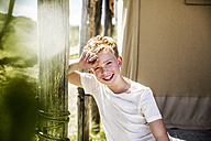 Portrait of happy boy on campsite - FMKF04340