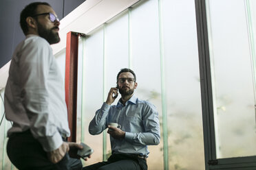 Two businessmen having a meeting in office - JOSF01355