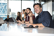 Business people sitting in conference room - ZEF14301