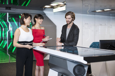Business people discussing in futuristic office - ZEF14373