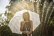 Portrait of smiling girl with umbrella - SARF03352